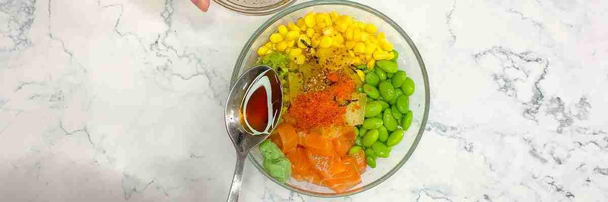 easy poke bowl adding yuzu sauce
