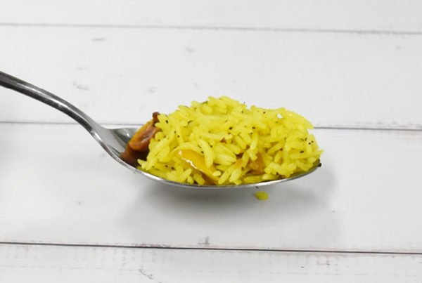 lemon rice with alchemy fibre in a spoon